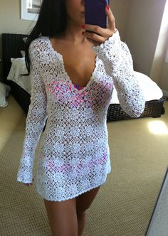 White Crochet Cover Up. How pretty! This top was sold on this person's website and is no longer available, however, for an experienced crocheter I think it could be duplicated. I sure would like the pattern!