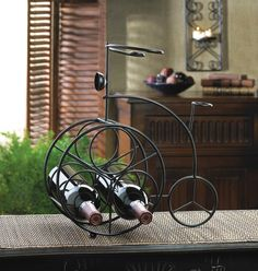 Place wine bottles in the front wheel of this charming iron bicycle and display your favorite bottles of wine with great taste! Perfect for the bar, counter or tabletop! Holds three wine bottles. #freeshipping