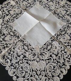 Stella buys and sells fine antique linens, antique lace, textiles, couture design, antique clothing, Chinese, European textiles.