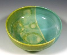 Aqua and lime green pottery serving bowl.