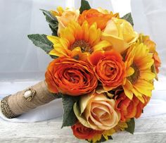 Silk Bridal Wedding Bouquet Sunflowers Yellow Roses Orange Ranunculus. $65.00, via Etsy.