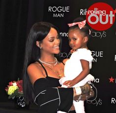Rihanna kisses babies, greets fans during fragrance launch in Atlanta