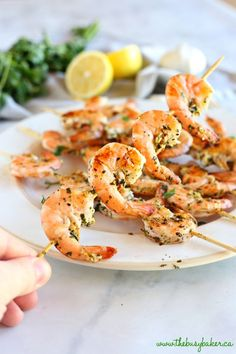 These Lemon Garlic Grilled Shrimp Skewers make the perfect addition to any healthy meal! Marinated in fresh garlic, lemon, and white wine, these grilled shrimp are perfect for summer barbecues or grilled indoors any time of year! Grilled Shrimp Skewers, Grilled Shrimp Recipes, Shrimp Recipes Easy, Grilled Meat, Seafood Recipes, Healthy Dinner Recipes, Healthy Snacks, Seafood Dishes, Shrimp Marinade