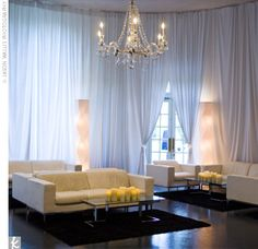 A chic sitting area with white leather couches, candle-covered coffee tables, and shag carpeting was lit by a glowing crystal chandelier and surrounded by wavy standing lights and draperies. Lounge Party, Wedding Lounge, Wedding Decor, Wedding Reception, Wedding Ideas, Reception Decorations, Event Decor, 26 November, Lounge Furniture