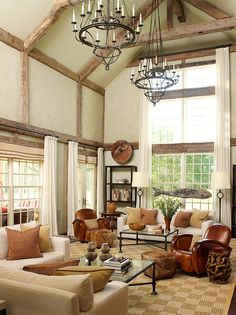 Two-story living room with vaulted and beamed ceiling