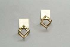 3-Dimensional Cube with square surface, Studs Earrings 14k / 18k Gold ------------------------------------------------------------------------------------------------- Simple & modern handmade studs earrings made of 14k or 18k yellow gold. Designed as a 3-Dimensional Cube with rounded corners, hang on a squared flat rough finish surface. It has a great urban chic. Those gold studs great for everyday urban look or for an elegant evening outfit. It is comfortable to wear. - Ready To sh...