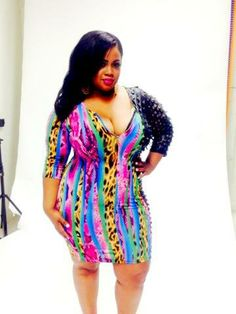 #BTS fun with The Curvy Plus Model Janna Plus Model donning the Plus Size Bodycon with Laser Cut Sleeves Zipper Front and Beautiful Mixed Prints Dress at http://chicandcurvy.com/bodycons/product/9893-new-plus-size-bodycon-with-laser-cut-sleeves-zipper-front-and-beautiful-mixed-prints-dress-1x-2x-3x