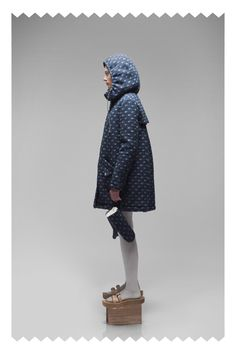 Love the butcher block sandals with the parka and oven mitts. Practical yet chic, the perfect combo.