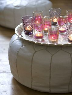 Moroccan Tea glasses used as candle votives resting on a Moroccan footrest...love!