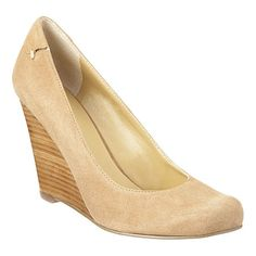 """As seen in the pages of  Lucky magazine...Round toe pump on high wedge. 4"""" wedge."""