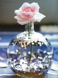 toss some sequins into the water ...it will make a beautiful centerpiece!.... must try this!!!!