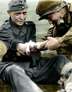 American Soldier   american helping wounded german soldier 1944 army sur geon general