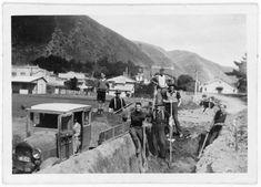 Workers lowering Beach and Wellington Roads, Paekakariki, Kapiti Coast c1930s .. posted OWR 5 June 2015