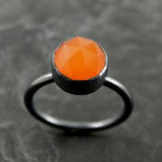 A bright orange chalcedony ring