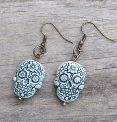 Small handmade porcelain sugar skull earrings by on Etsy Flower Earrings, Drop Earrings, Sugar Skull Earrings, Bead Shop, Tropical Flowers, Polymer Clay, Porcelain, Buy And Sell, Pendant Necklace