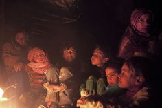 3/18/2012  A Syrian family rests around a fire as they wait for Free Syrian Army rebels to help them cross the Syrian border into neighboring Turkey.