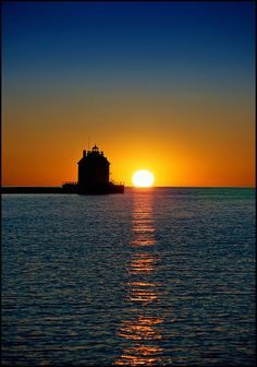 lighthouse #sunset #water #reflections
