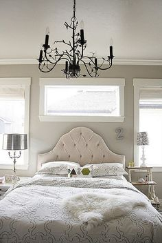 upholstered headboard and mismatched nightstands