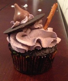 Halloween cupcakes. Witches hat and broomstick.
