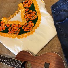 """Embroidered Frida Top NWOT Stunning white and yellow hand embroidered authentic artisanal v-neck top. Pair this with jeans or shorts in the summer with chic huaraches. One size fits most, fits like S/M. Shoulder to bottom measures: 25"""" and bust measures: 20 1/2"""" NWOT, due to fair trade nature of product, price is firm. Tops Blouses"""