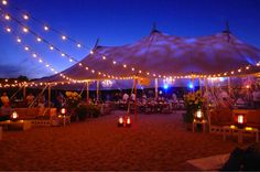 Tidewater at Ocean House.  A nice combination of gobo uplighting and bistro lights.  This photo from Newport Tent Company's board.