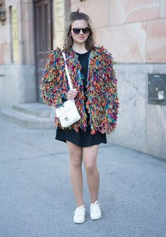 """""""I'm wearing a jacket I've made out of old jeans and colourful yarn for my first collection. The dress and the bag are my mom''s old. Lately I've been inspired by different textures and handicrafts. I like to wear clothes that are second hand or I've made myself. I love quirky combinations of prints and colours."""""""