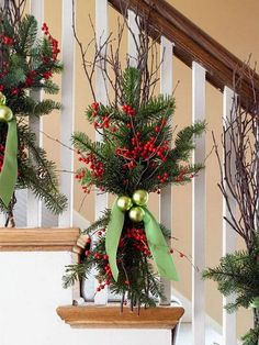 tie up some tree branches and berry branches with an elegant light green ribbon for stairs