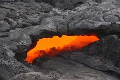 Lava skylights are one of nature's–and Hawaii's–little delights. An opening in a thin crust of pahoehoe reveals streaming lava, molten rock flowing down the side of Kilauea on Hawaii's Big Island at more than a thousand degrees.