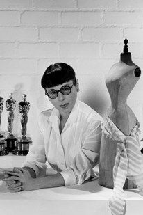 Today's google homepage is honoring Edith Head, one of Hollywood's most celebrated costume designers.  Today would have been her 116th birthday. She won 8 Oscars for costume design -- the most by a woman -- creating looks for movies such as Roman Holiday, Carrie and All About Eve. She is actually the inspiration between Edna Mode, the costume designer in the Incredibles.
