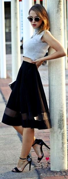 A-line skirt. Ladylike, young, and edgy with cropped sweater,  stiletto sandals and vintage shades.  Yeah
