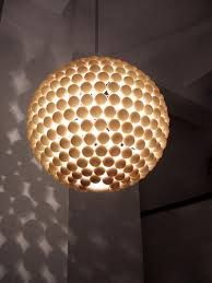 Don't put away that hot glue gun just yet! Now run out to Sports Authority and empty out their existing stock of ping pong balls. DIY instructions for this awe-inspiring ping pong pendant can be found here. Love the shadows it casts on the adjacent walls. Diy On A Budget, Decorating On A Budget, Ping Pong Lights, Diy Luz, Diy Luminaire, Ball Lights, Diy Décoration, Light Project, Pendant Lamp