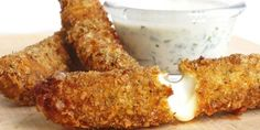 You know you love them -- Crispy gooey homemade mozzarella sticks served with a refreshing herb-packed buttermilk dip. Homemade Mozzarella Sticks, Mozzarella Cheese Sticks, Holiday Appetizers, Yummy Appetizers, Appetizer Ideas, Milk Recipes, Cheese Recipes, Cookie Recipes, Food On Sticks