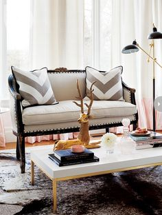 Style at Home: French style linen settee with nailhead trim topped with gray and white chevron pillows. ...