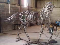 Sculpture made of scrap horseshoes that were reforged, shaped, and welded together. Stands about 17 hands tall. Photo taken before it was powder-coated. By sculptor William Wilson.