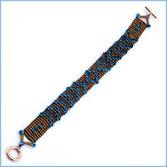 DIY Bracelet: Blue Drop Flechas Loomwork Cuff using the Beadalon Jewel Loom.