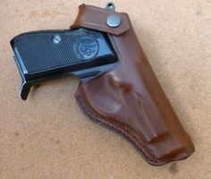 Italian design classic in British made holster. Beretta 70 series leather belt holster with double row seam custom made by makeitjones.co.uk