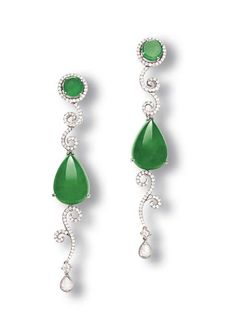 A PAIR OF JADEITE AND DIAMOND EAR PENDANTS  Each set with a pear-shaped jadeite cabochon and jadeite disc top of bright emerald green tone and good translucency, enhanced by diamond scrolls to the rose-cut diamond terminal, mounted in oxidised 18k white gold