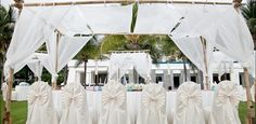 What the reception set up will look like. Canopy tables on the lawn beside the ocean.