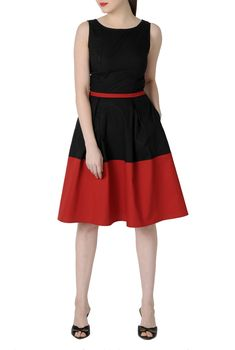 Vivid color vitalizes our fifties fit-and-flare dress and spans over to the mod sixties with a contrast color blocked hem and piped waist.