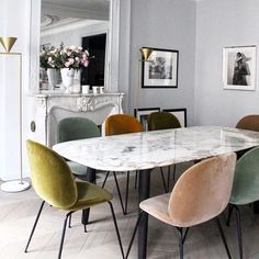 Top trending pins for June, see the rest of the favourites for interiors and style inspiration! Modern dining room interior setup with marble dining ding table and multi toned velvet dining chairs Dining Room Design, Dining Room Chairs, Coloured Dining Chairs, Mismatched Dining Chairs, Office Chairs, Marble Dinning Table, Mixed Dining Chairs, Round Marble Table, Colorful Chairs