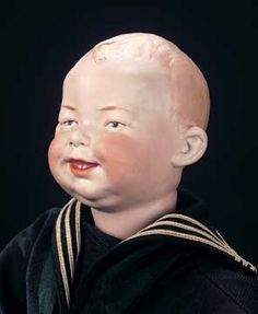 """German Bisque Laughing Character with Two Teeth 16"""" Marks: 7746 Germany Heubach (sunburst mark). Comments: Gebruder Heubach,circa 1912. ,wearing antique sailor costume including sailor hat labeled """"H.M.S. Neptune"""",middy jacket,trousers,shoes,socks,and carrying a toy wooden violin."""