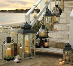 If I had a beach house (or a lake house), I would have lanterns all over the place too Coastal Living, Coastal Decor, Coastal Style, Outdoor Lighting, Outdoor Decor, Lantern Lighting, Beach Lighting, Outdoor Candles, Accent Lighting