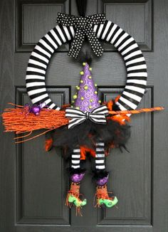 "this is the CUTEST witch wreath I've ever seen.. it's a nice relief from the traditional ""witch ran into the door"" door decor that I've seen for years. This is so cute."