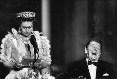 President Ronald Reagan laughs at a joke made by Queen Elizabeth II during a state dinner at the M.H. de Young Museum, March 3, 1983