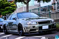 Quick snap of the Nissan Skyline GT-R V-spec II Nur on nice set of Volk TE37 wheels and front set of Nismo fenders. Skyline Gtr R34, Nissan Skyline, Nissan Infiniti, Godzilla, Supercar, Dream Cars, Car Manufacturers, Bike, Amazing Cars