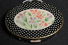 Lot:302: Vintage oval enameled compact featuring flowers on, Lot Number:302, Starting Bid:$20, Auctioneer:Cedarburg Auction & Estate Sales LLC, Auction:302: Vintage oval enameled compact featuring flowers on, Date:02:00 PM PT - Aug 16th, 2012