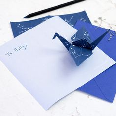 A new and interesting way to write letters. A letter writing set with blue and white origami papers with star constellations design and