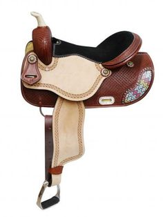 "Available in a 14"", 15"", or 16"", this beautiful saddle set features dark oil basket weave tooled skirts accented with a painted pink and purple Navajo design. The saddle comes equipped with front D ri"