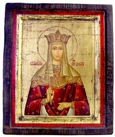 "Hand-painted wooden Saint Olga icon on a golden background. St. Olga was the first recorded female ruler in Russia and the first member of the ruling family of Kiev to adopt Christianity. She was canonized as the first Russian saint of the Orthodox Church. St. Olga was the widow of Igor I, Prince of Kiev.  Size: 8 ½"" x 7"". Date: 1800 AD."