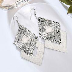 80s Earrings, Fashion Earrings, Silver Earrings, Dangle Earrings, Fashion Jewelry, Earring Trends, Jewelry Trends, Earring Hole, Stud Earring